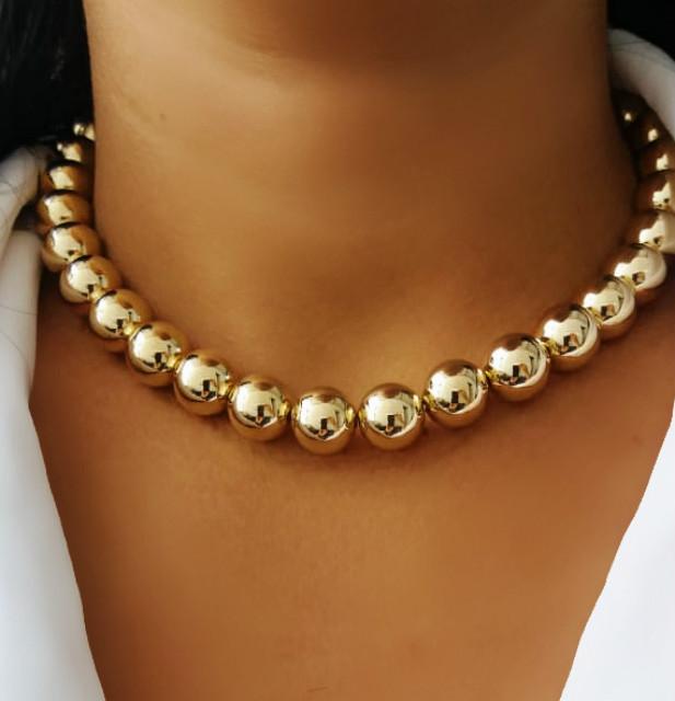 colar de bola da karola dourado