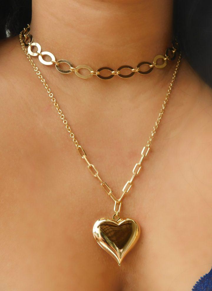 colar com pingente de coração dourado